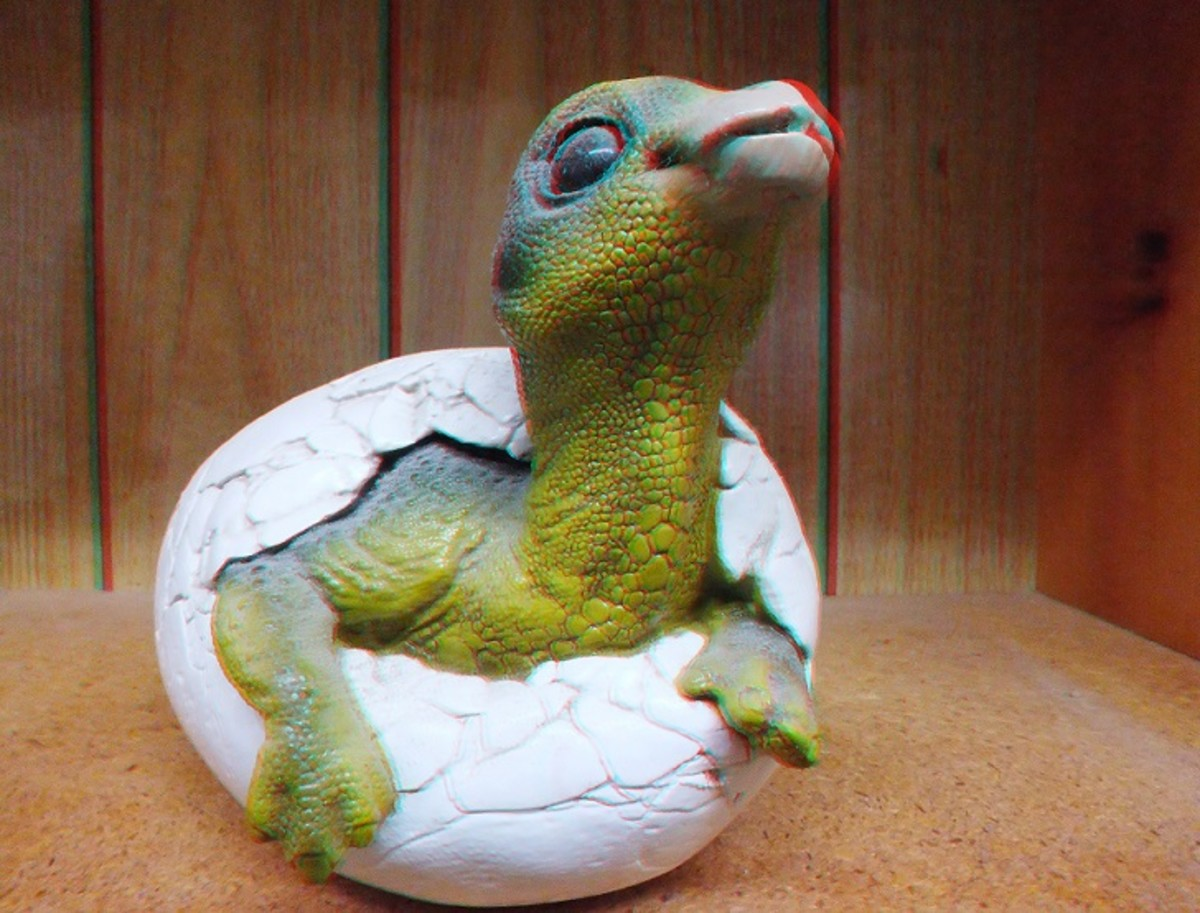 Red cyan 3D stereoscopic picture of a dinosaur coming out of an egg.