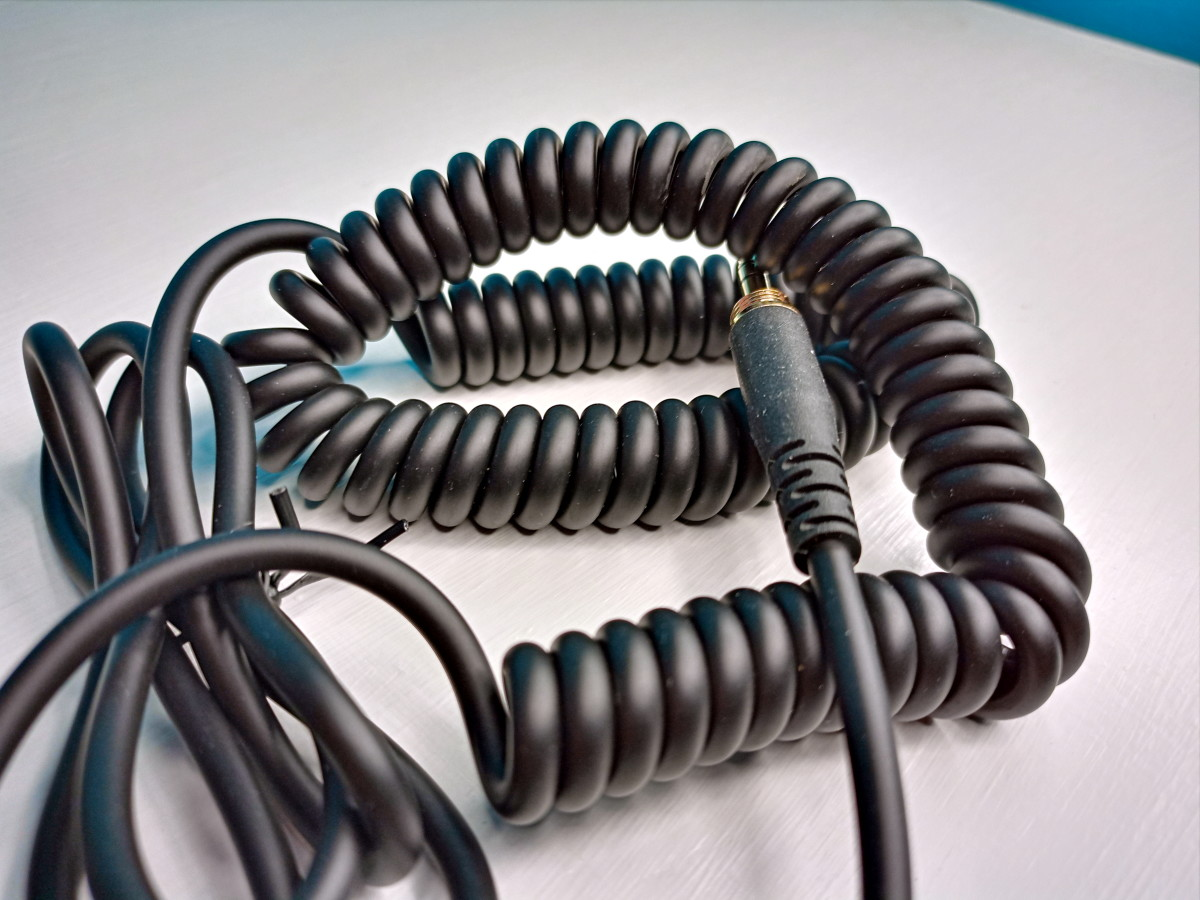 The Vogek Over-Ear DJ Headphone's lead is partially composed of curly cord