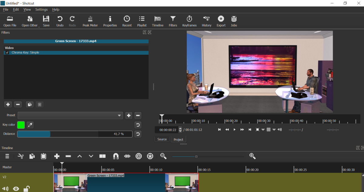 Use the Key color and the Distance parameters if the green screen hasn't disappeared entirely.