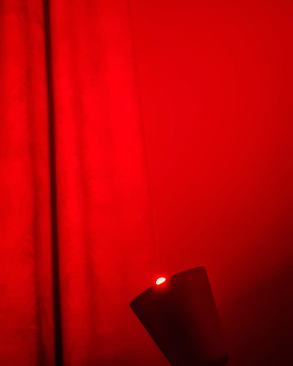 The LOHAS LED E14 Smart Candle Colour Changing Light Bulb in my bedroom, set to red.