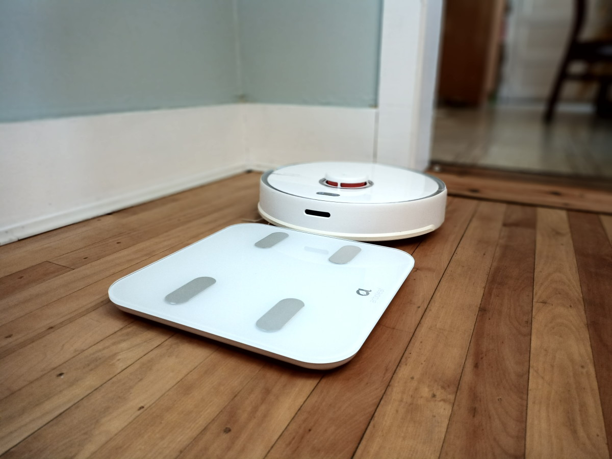 This smart scale works well with robotic vacuums.  My robot carefully edges around the scale as it cleans the floor