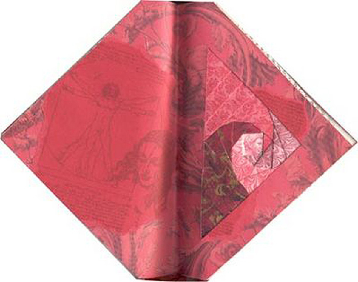Iris folding in an altered book, by Lisa Vollrath