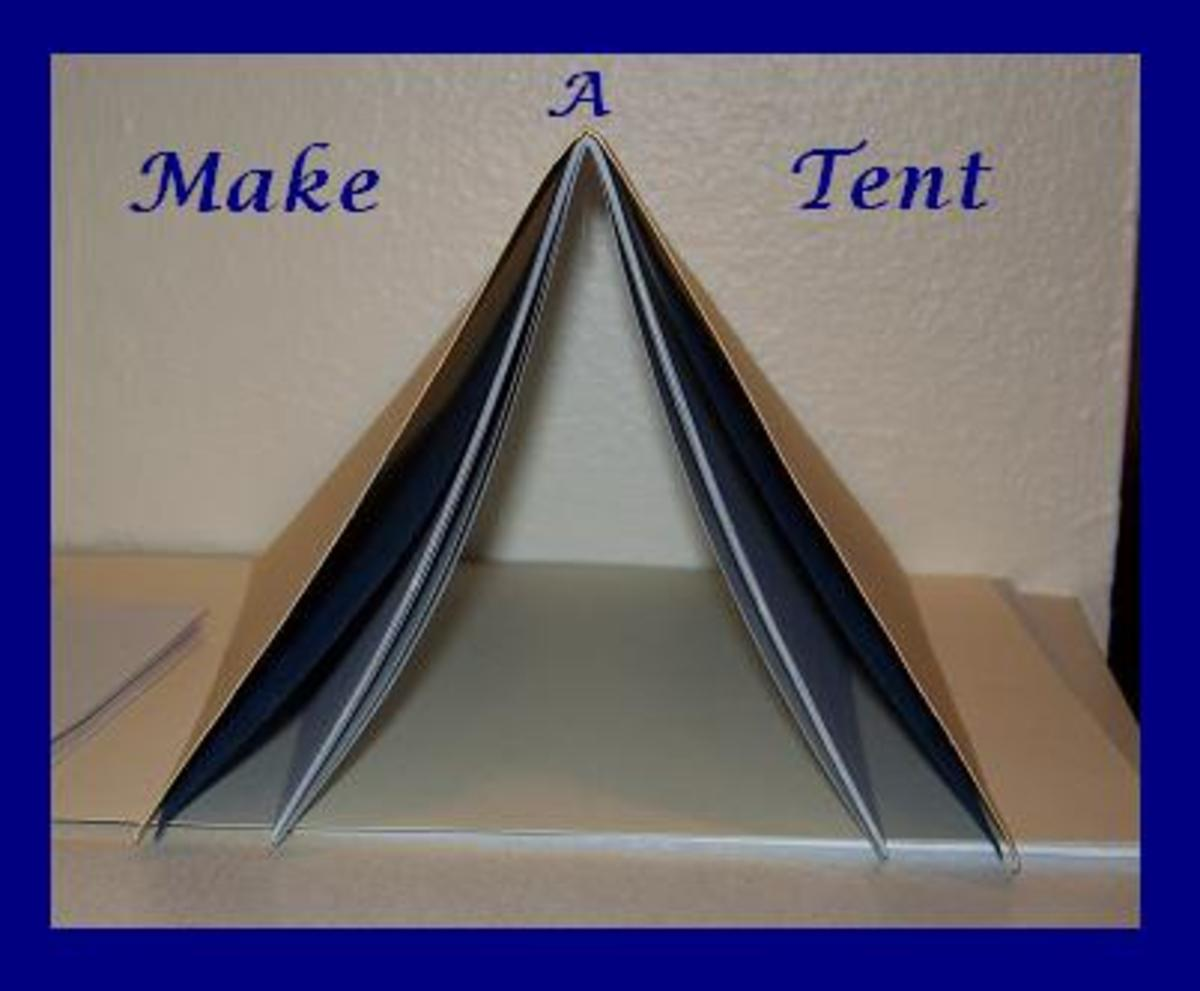 After folding your pages, stack them together like a tent.