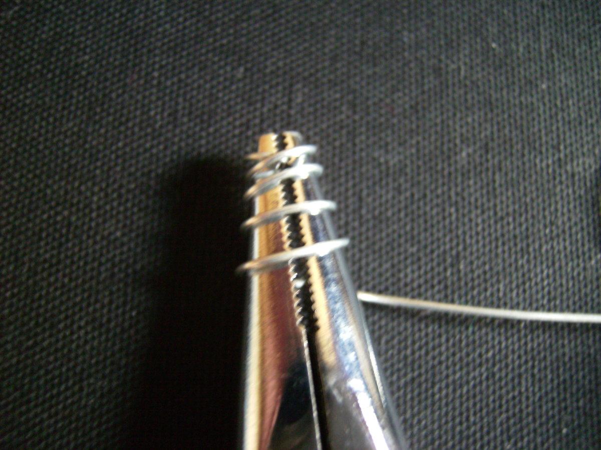 Twist the wire around the pliers.