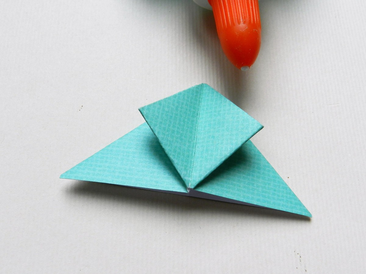 The tips are folded under and up to the top