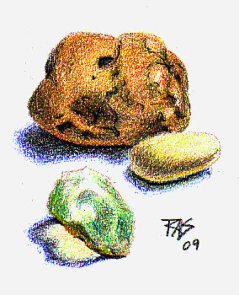 Three rocks from life in Coloursoft colored pencils on sketchbook paper by Robert A. Sloan.