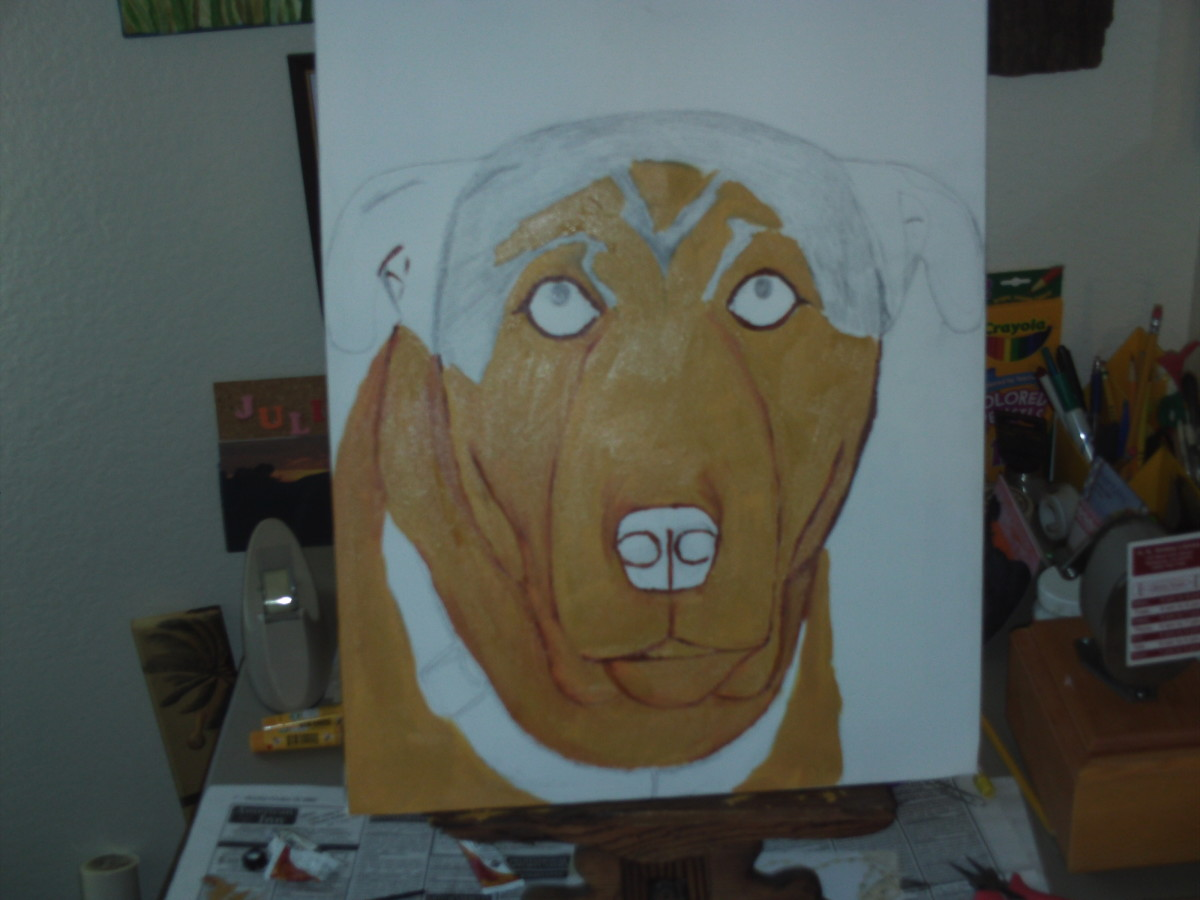 Here I have finished painting in the beige portions of Buster' face.