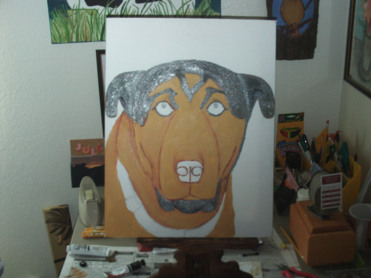 Continue to paint the darker portions of Buster's face.