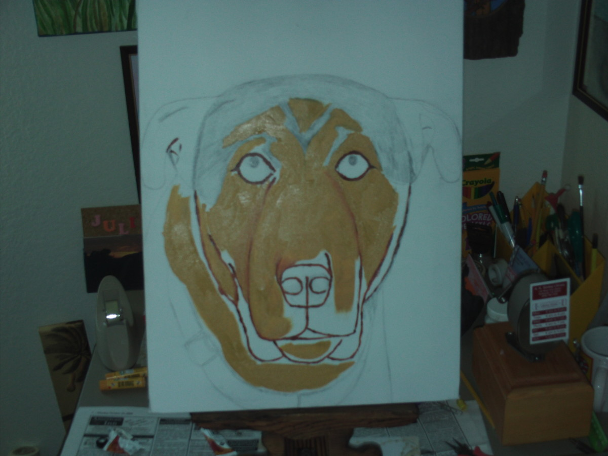 Here I use sienna paint to outline the features of Buster's face.