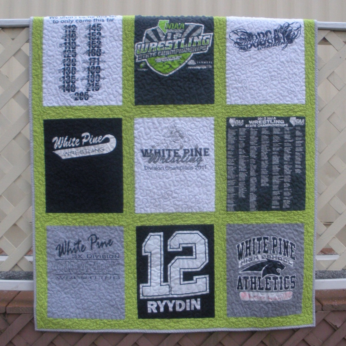 Green, White, Black, and Gray Quilt