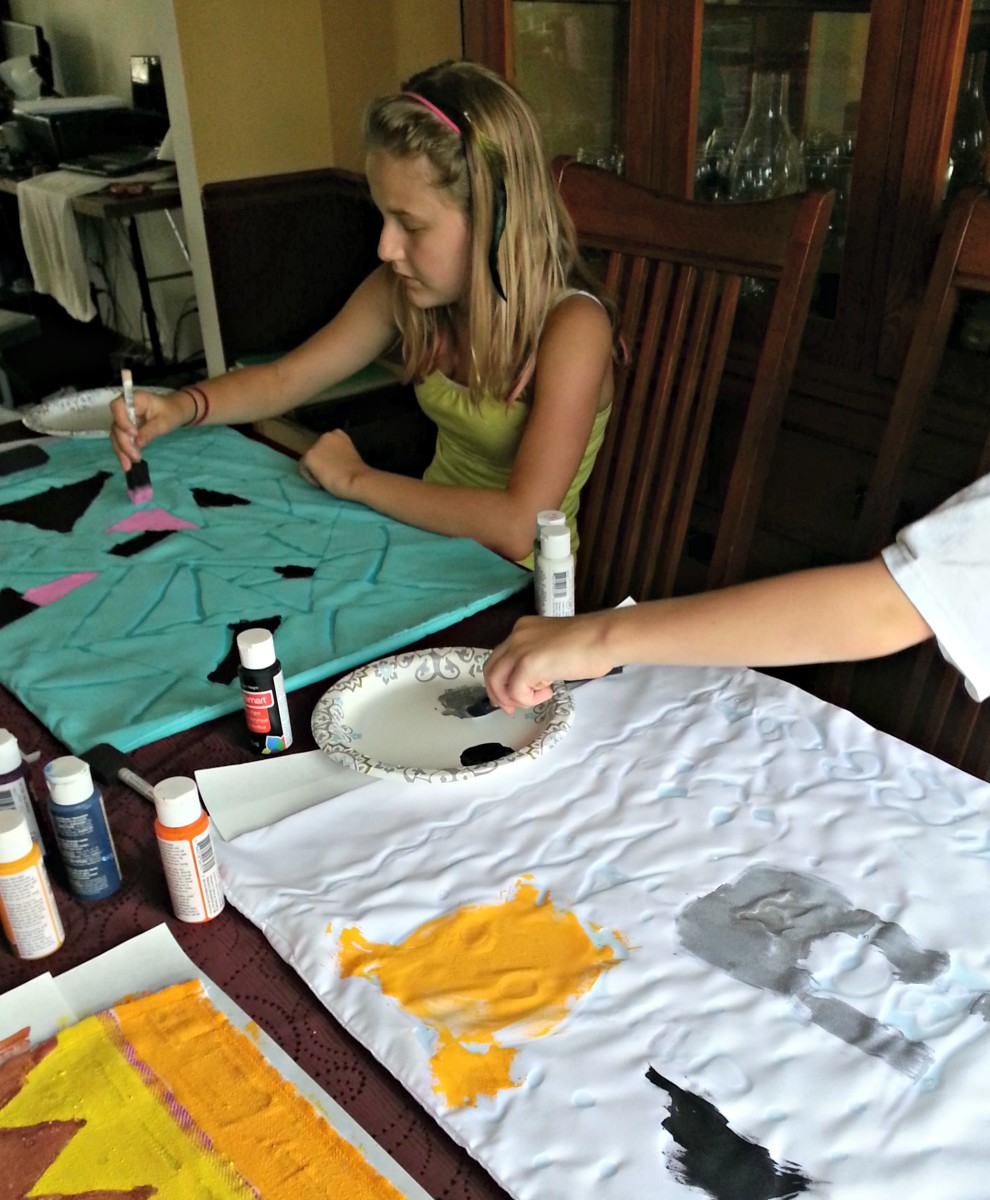 It's very important for the fabric to be completely covered in paint in order for the batik process to work.
