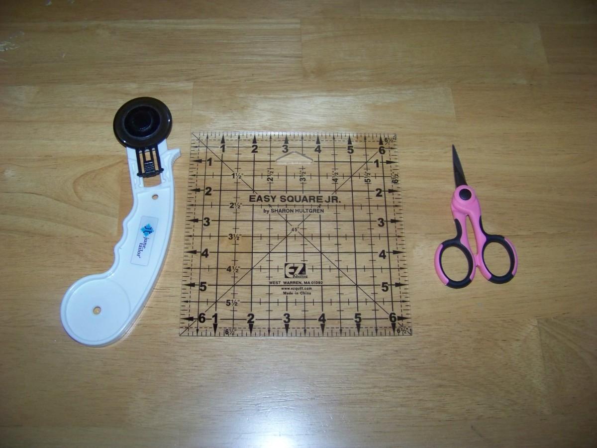 "Supplies: rolling cutter, 6""x6"" acrylic block, sharp snips"