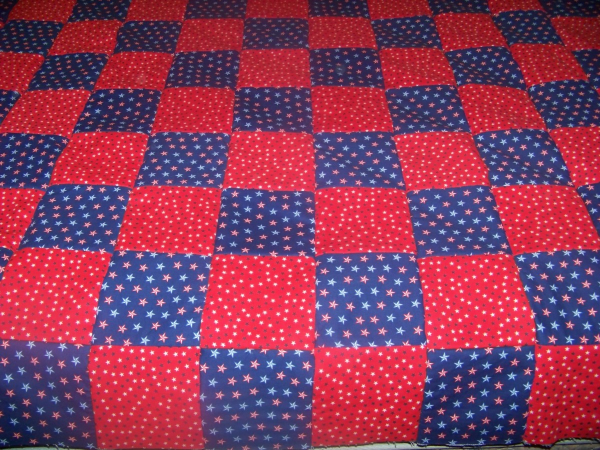 all rows sewed together with backing alternating red and blue material.