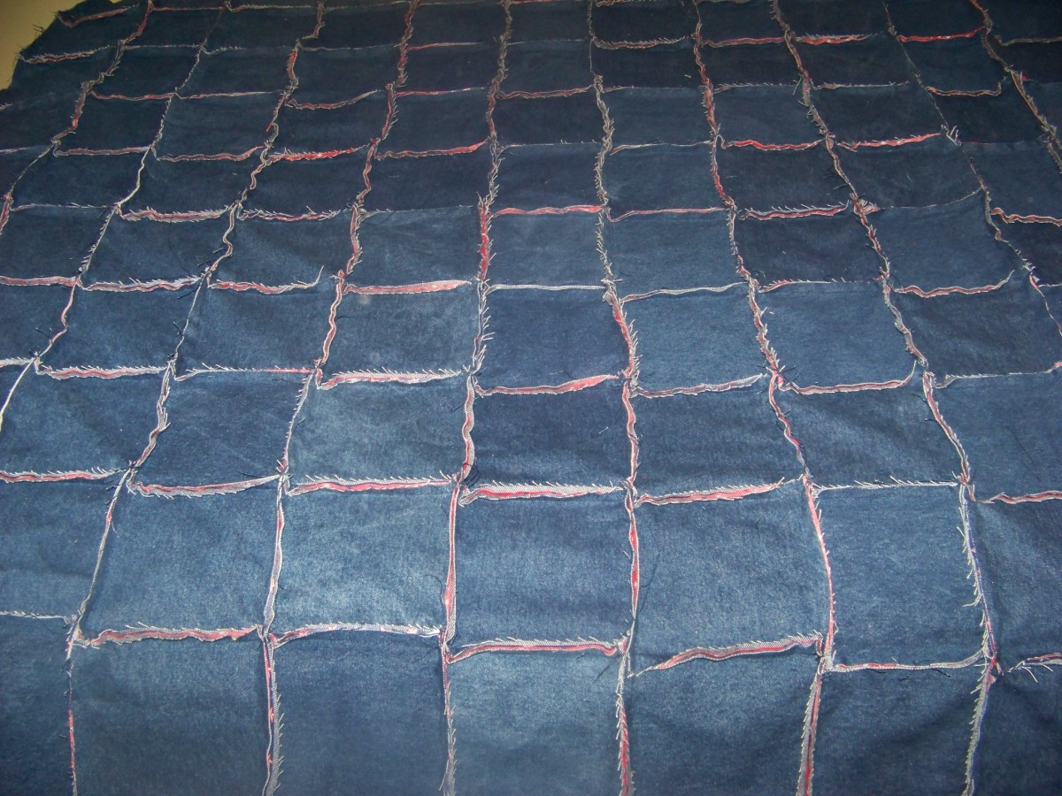 All rows sewed together denim side with seams showing.