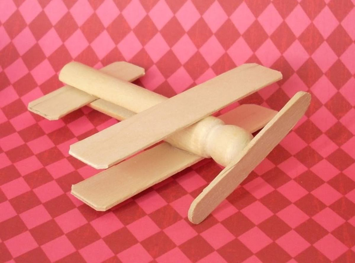 a.  Airplane made from round clothespin and craft sticks