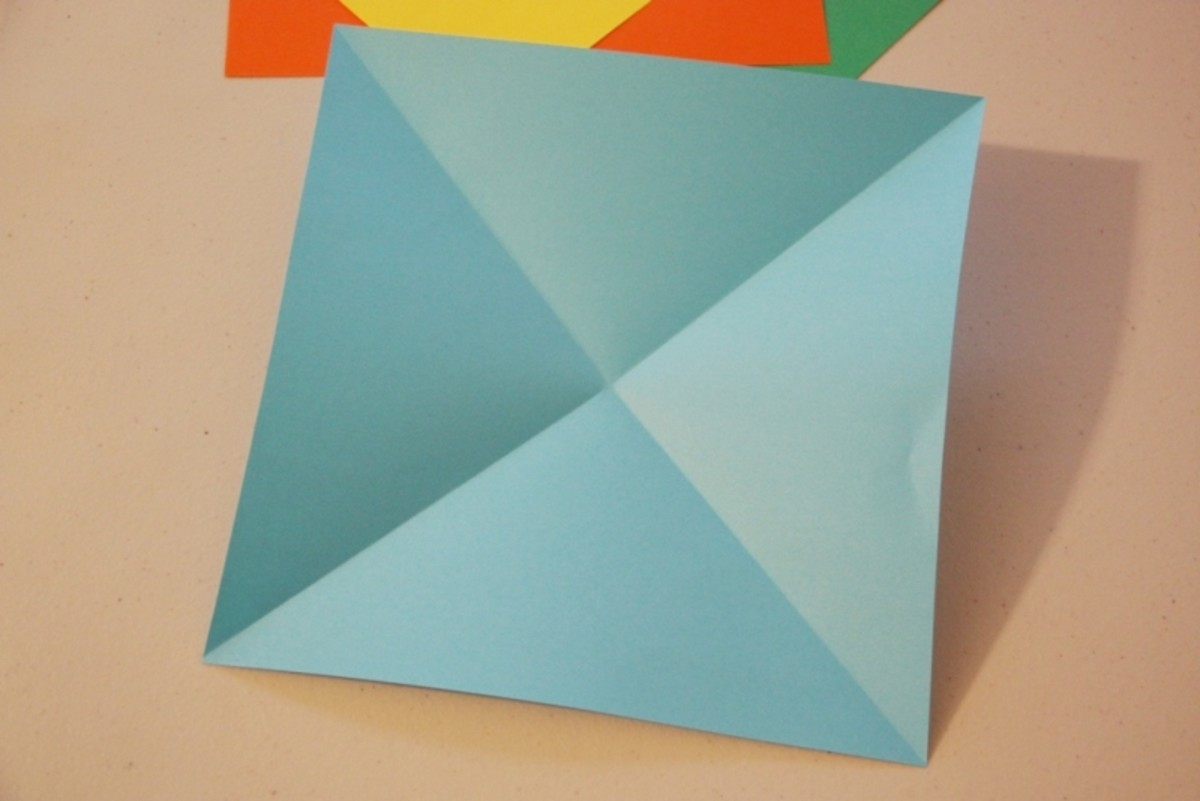 Fold the squares on both diagonals.