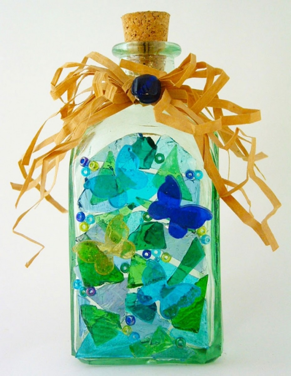 Butterfly beaded stained glass recycled bottle
