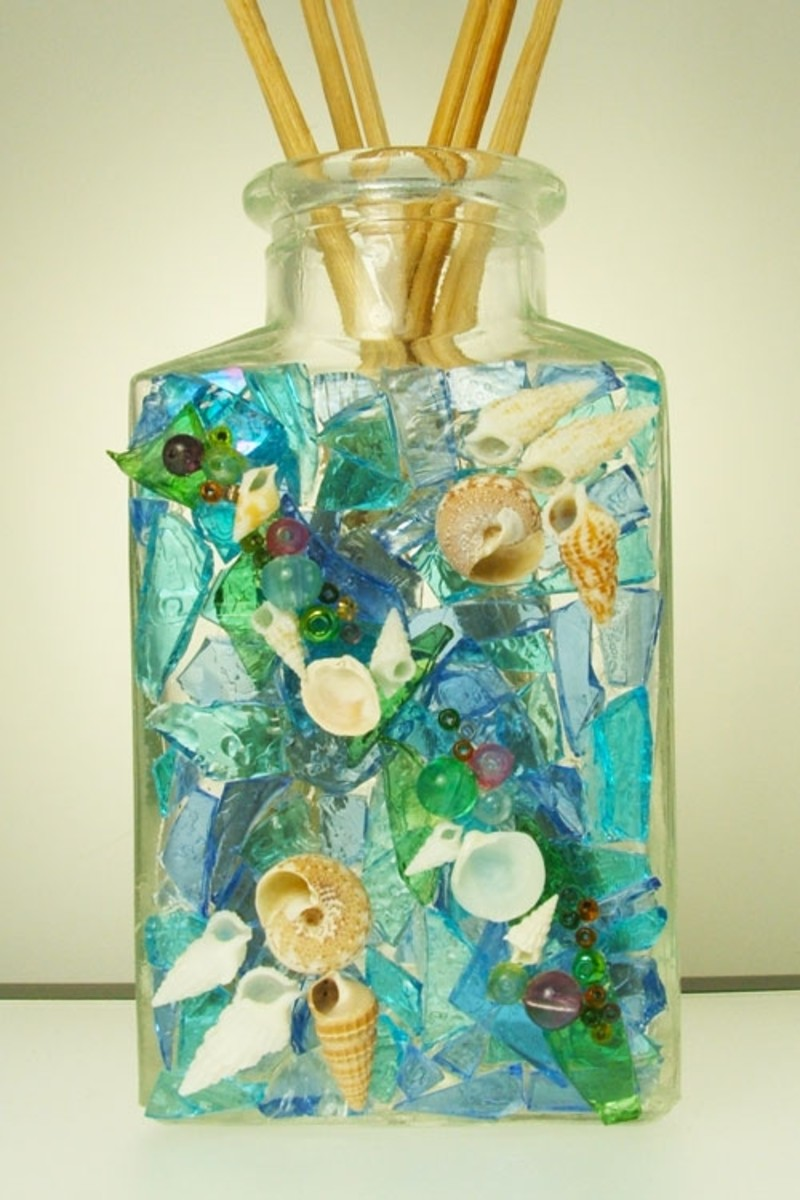 Glass Craft with seashells, beads, and stained glass cobbles