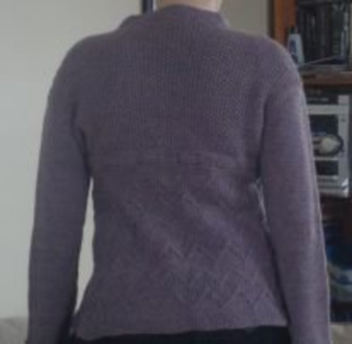 It lies flat, curves appropriately and the stitches are even. Overall, a better fit.