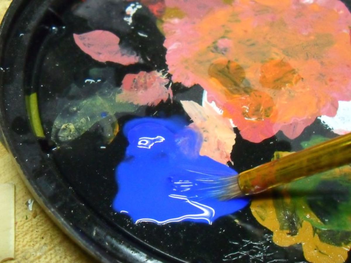 Mixing colors on a tray.