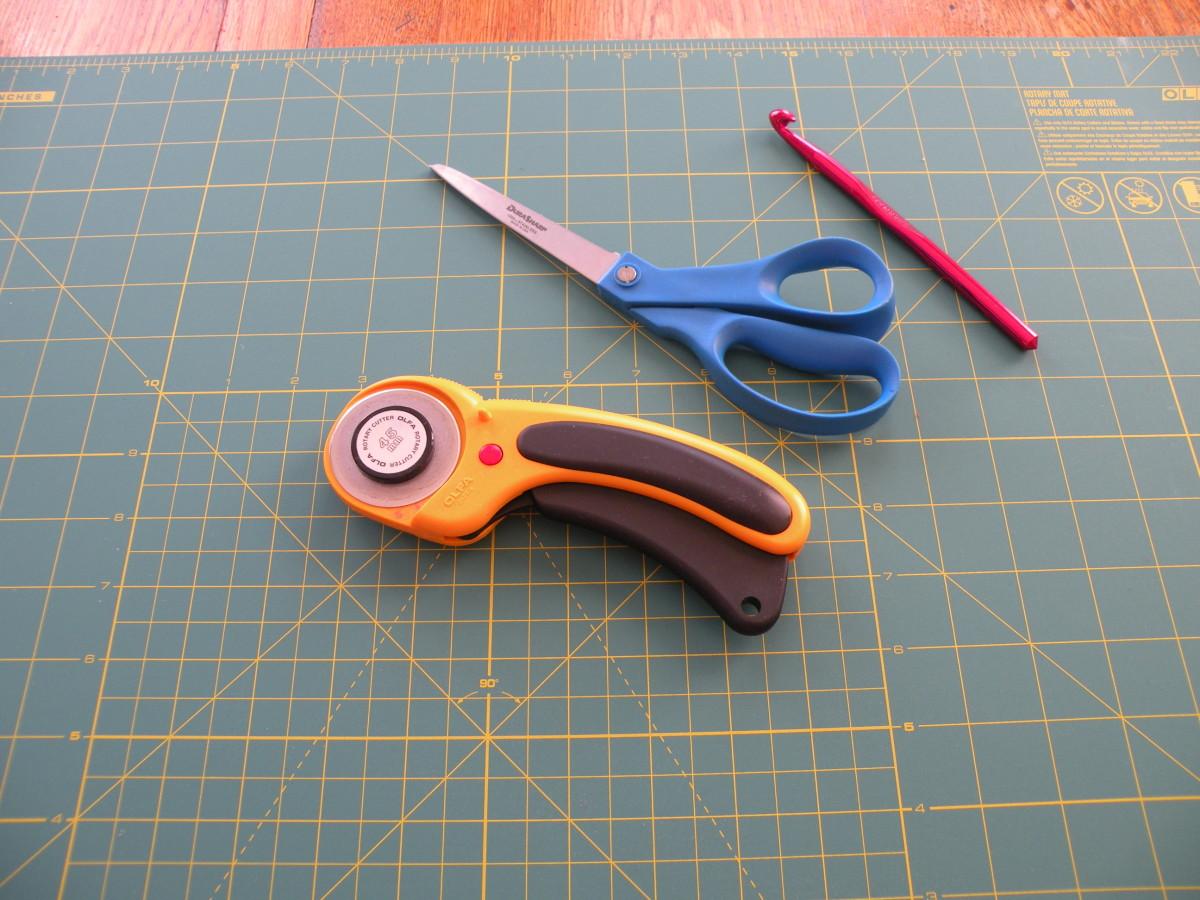 You'll need a rotary cutter or scissors, a cutting mat, crochet hook and scissors.