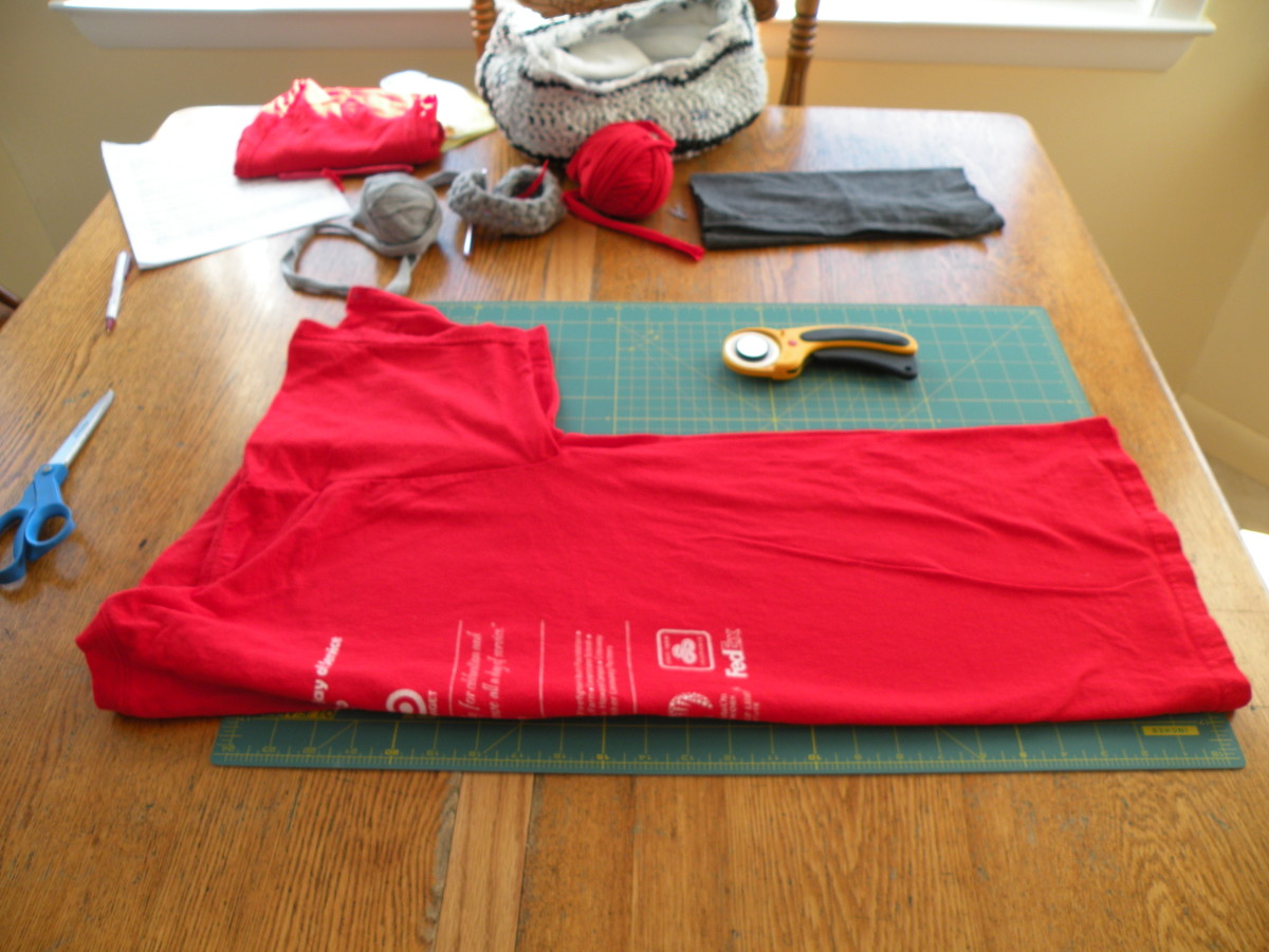 Fold the T-shirt in half with the sleeves together.