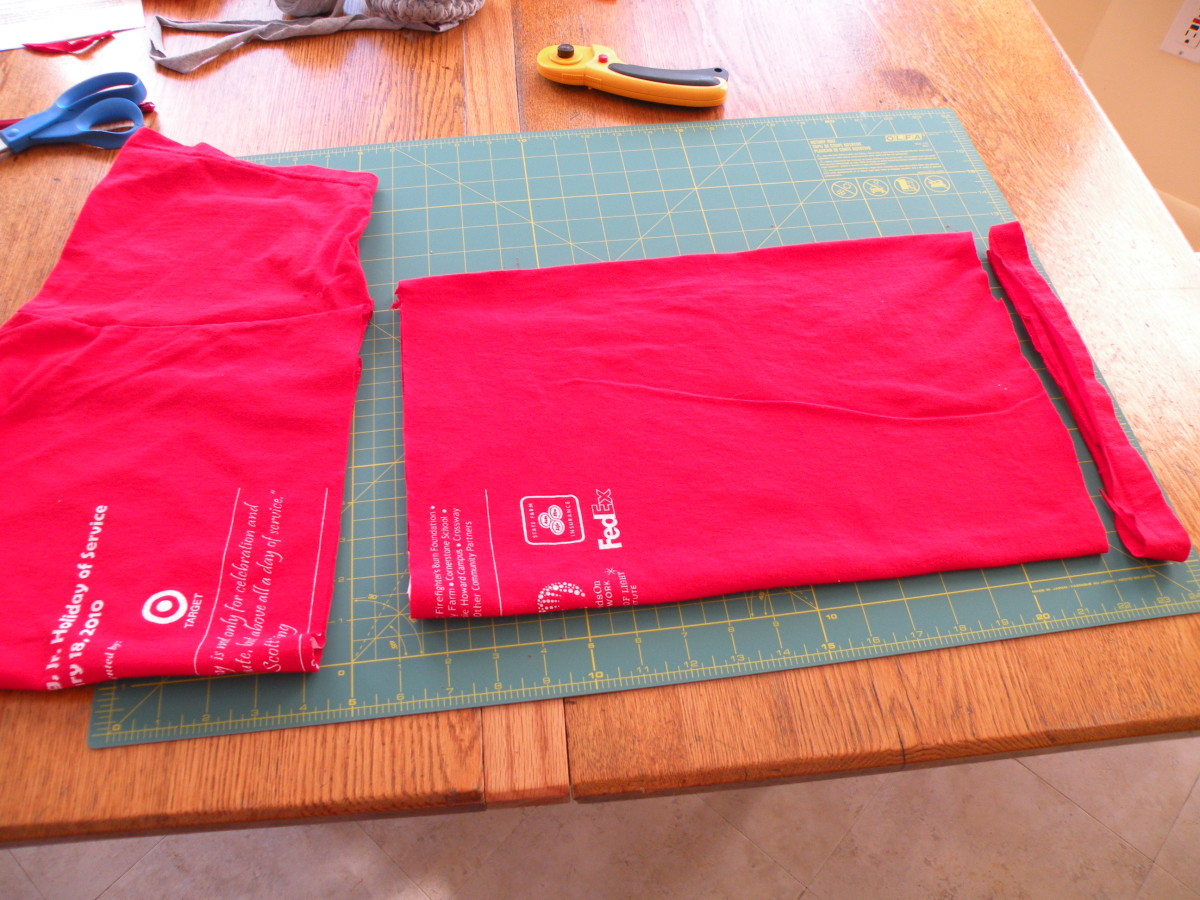 Cut off the top portion just under the sleeve and cut off the hem just above the stitching.