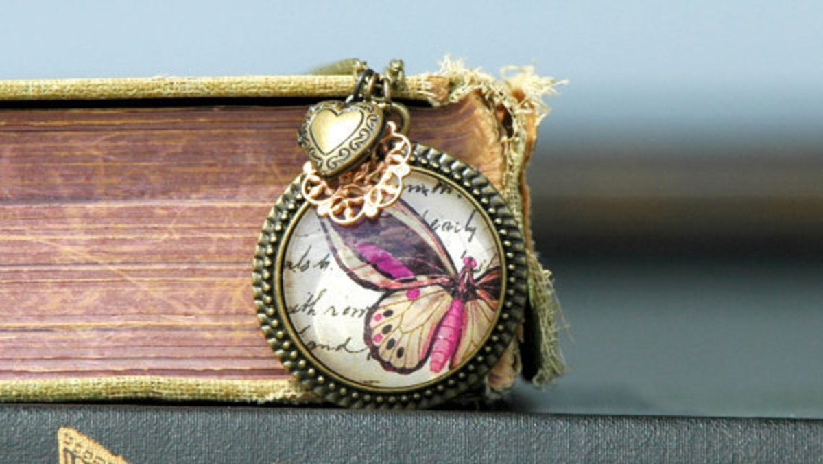 Fuchsia Mae . antiqued brass & glass . Butterfly Charm Necklace