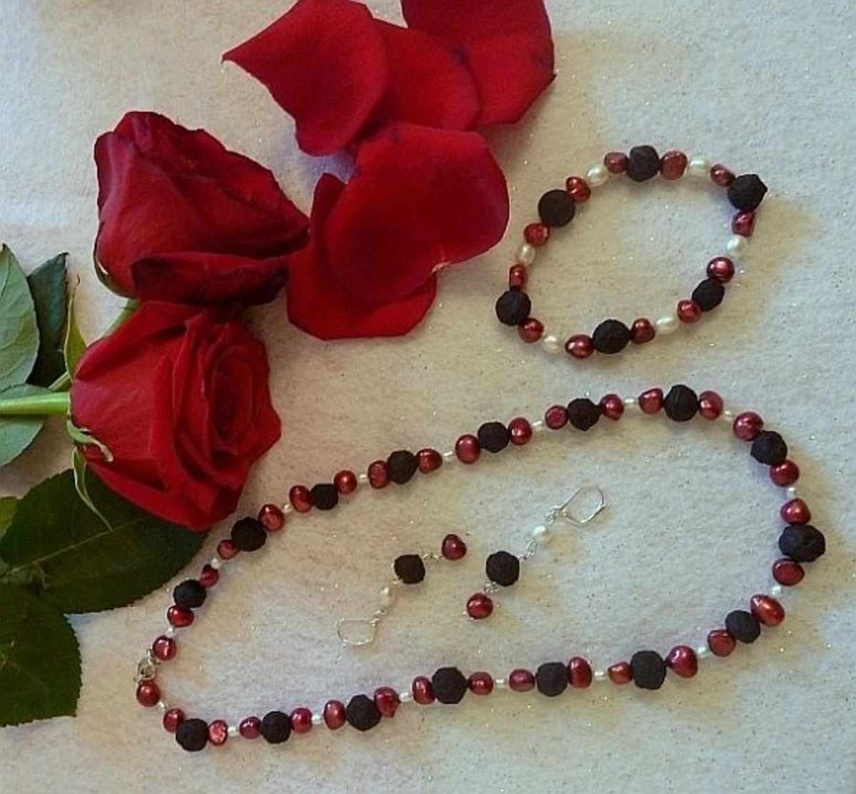 Jewelry set made from red roses.
