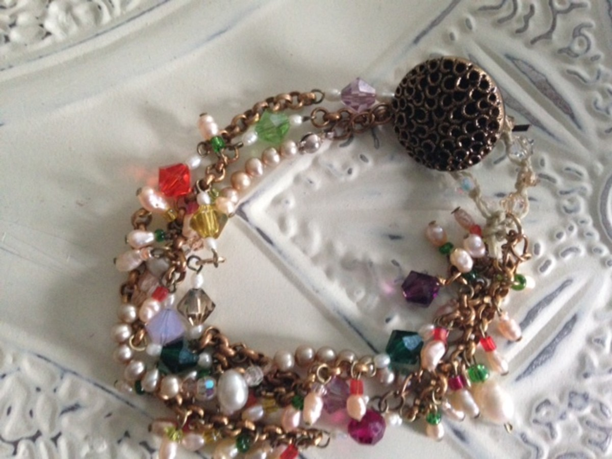 Sundance-inspired Gypsy button bracelet made with freshwater pearls, crystals, seed beads, leather, gold chain and a vintage button clasp.