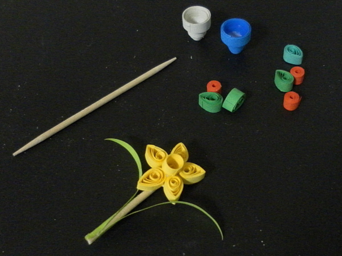 Glue the flower and leaves to a toothpick.