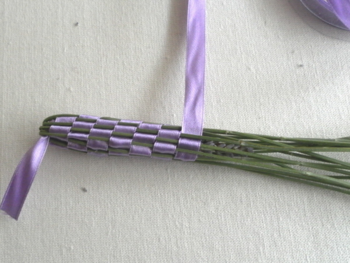 Continue weaving until the flowers are covered. Then wrap the ribbon around the stems.