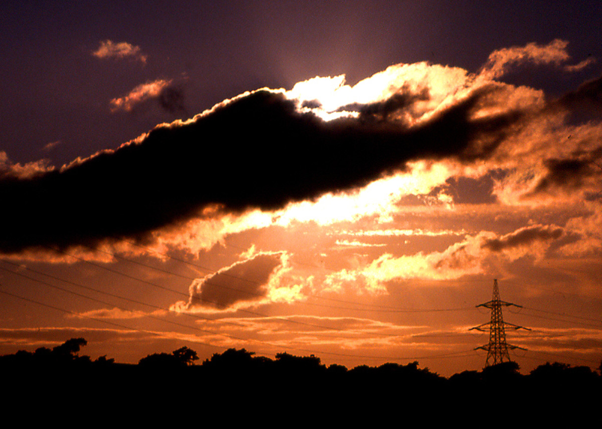 Silhouetted cloud and landscape