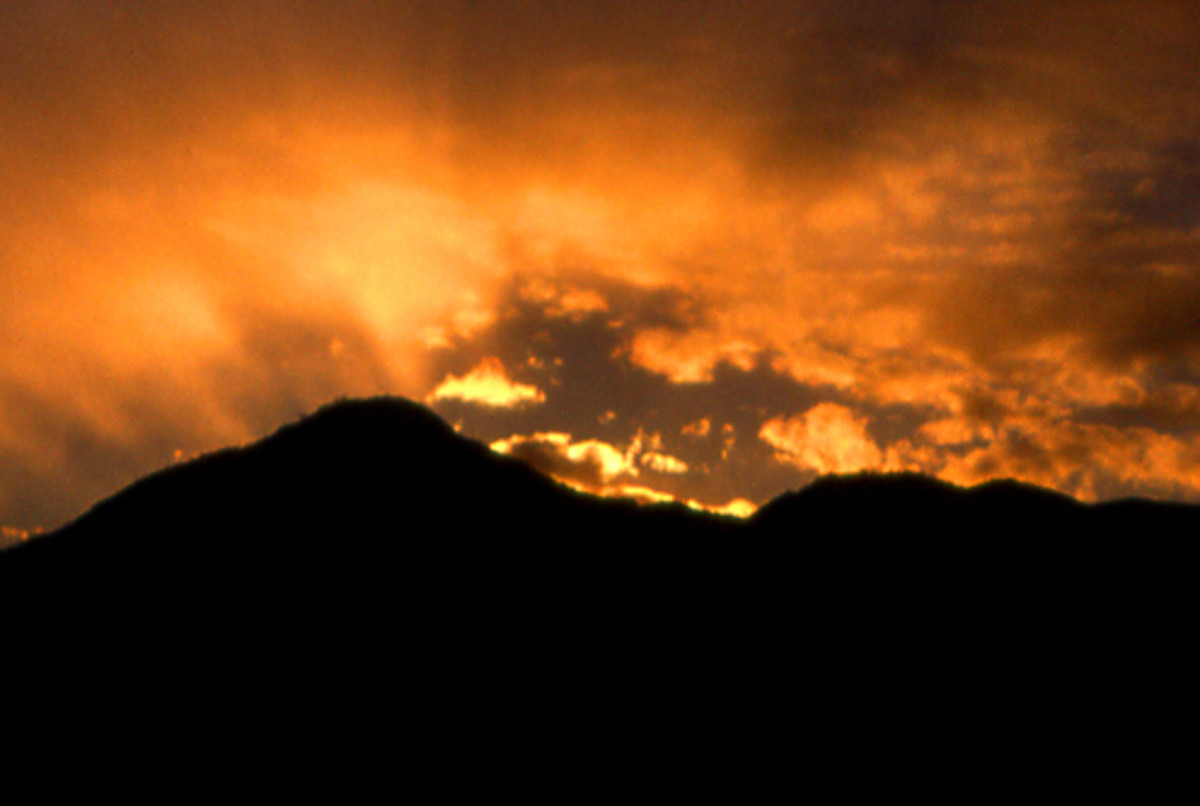 Mount Nantai in Japan, silhouetted against the remaining rays of sunlight after sunset