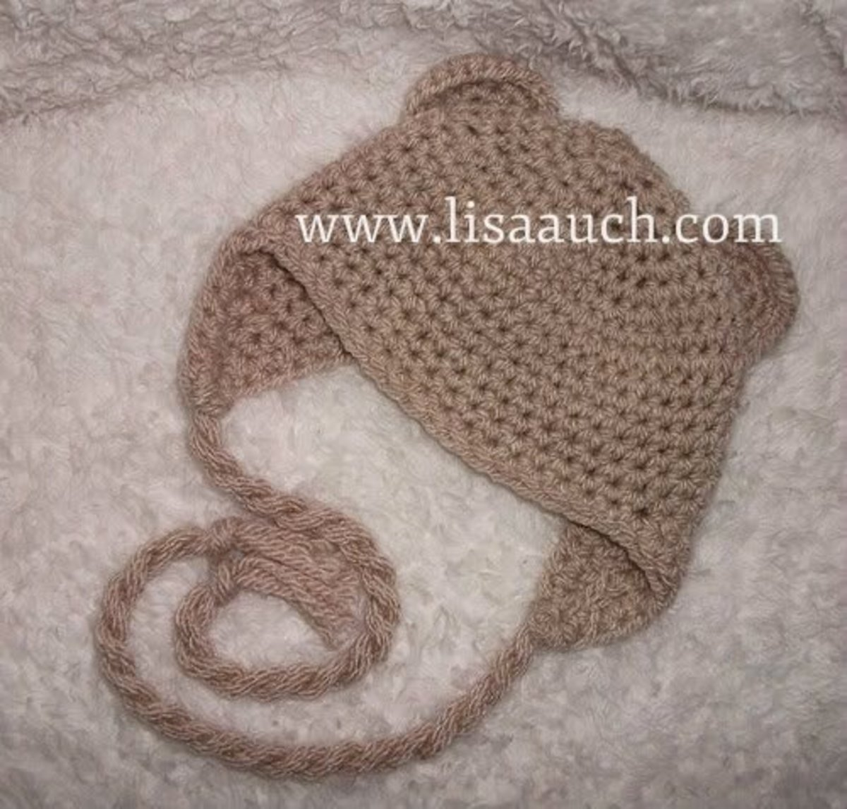 Make a baby animal hat with ears and earflaps to keep baby cosy.