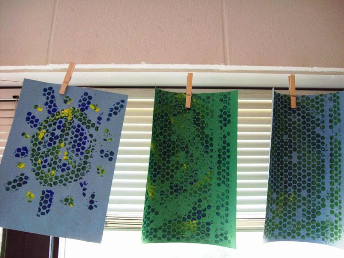 Hanging artwork from a cord or wire is a great do-it-yourself project.  Use clothespins to secure in place.