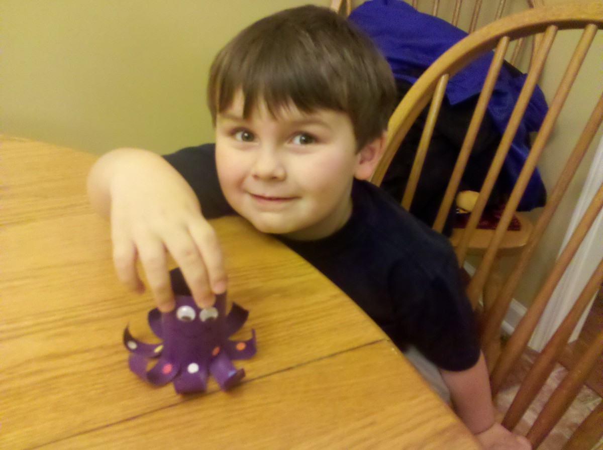 My son proudly showing off his finished octopus!