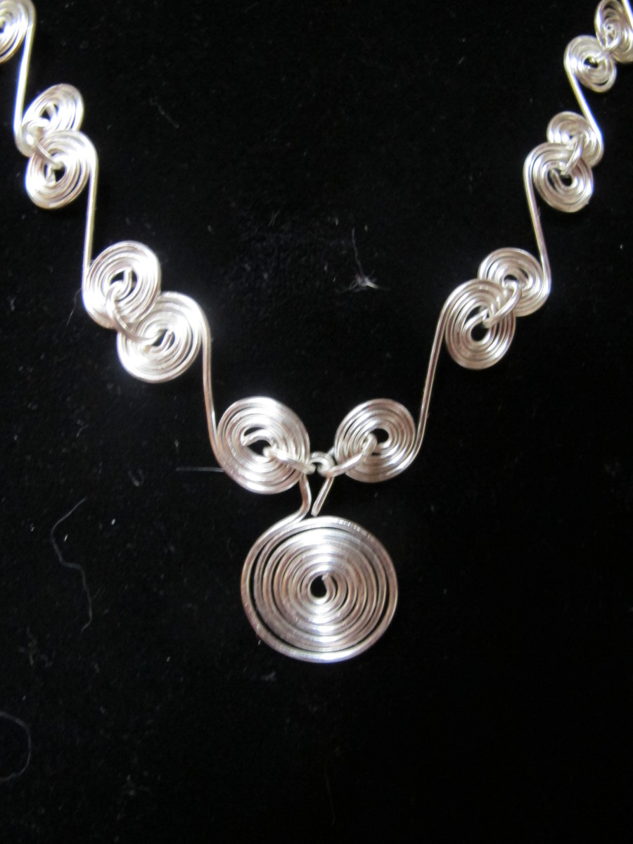 Here, spirals are looped together to form a wavy design.
