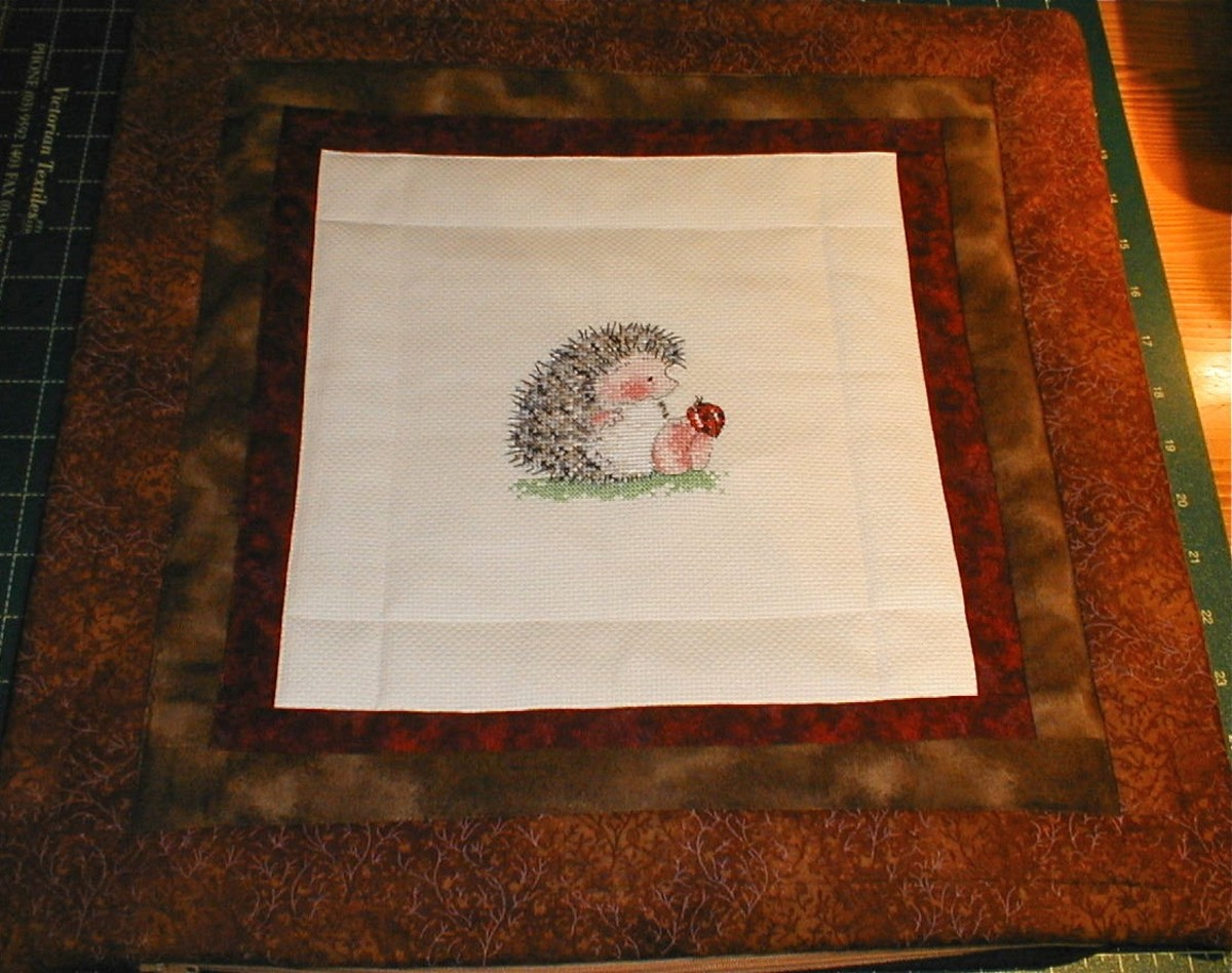 one of my quilted cross stitch pillows given as a gift to a hedgehog fan