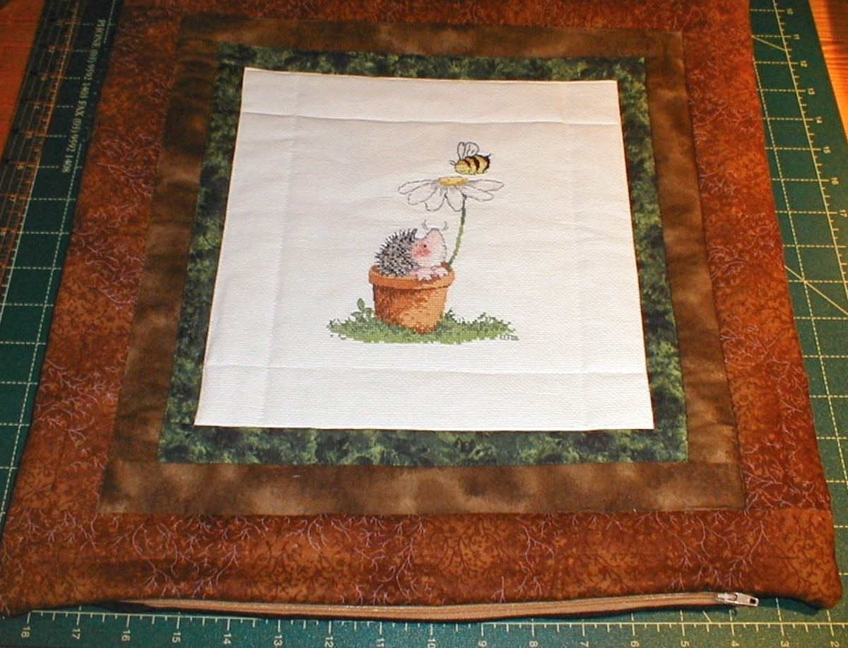 One of my quilted cross stitch pillows - given as a gift to a hedgehog fan!
