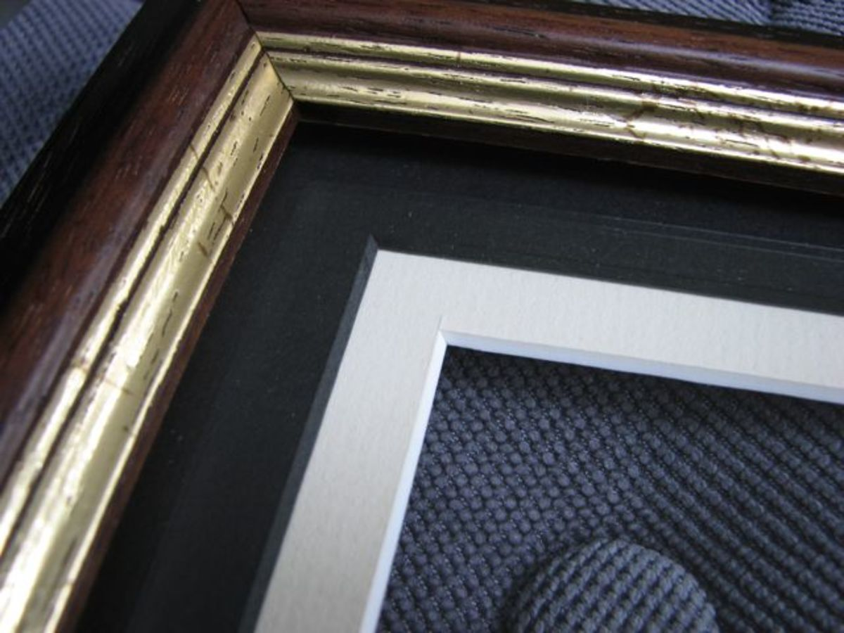 Glass and mats placed in the frame. I chose a darker top mat so there would be more of a contrast between the gold edge and the cream mat.