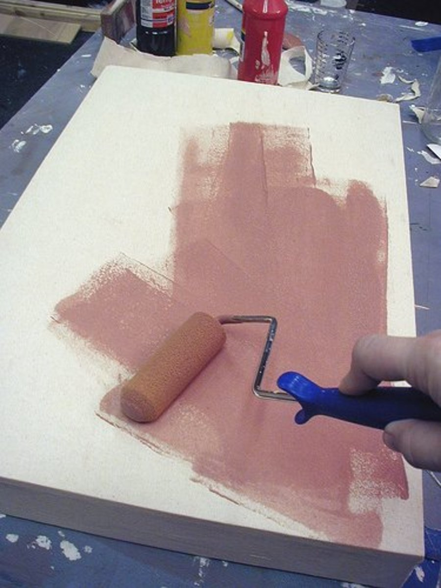 A colored gesso application creates a tinted ground. You can brush the gesso on or use a roller.