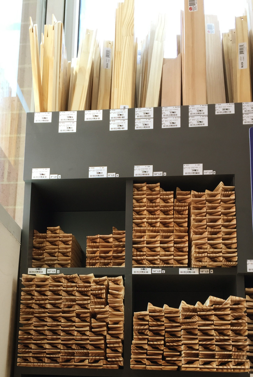 Stretcher bars are sold by size, ready to use. Pictured, stretcher rack at Dick Blick art materials store.