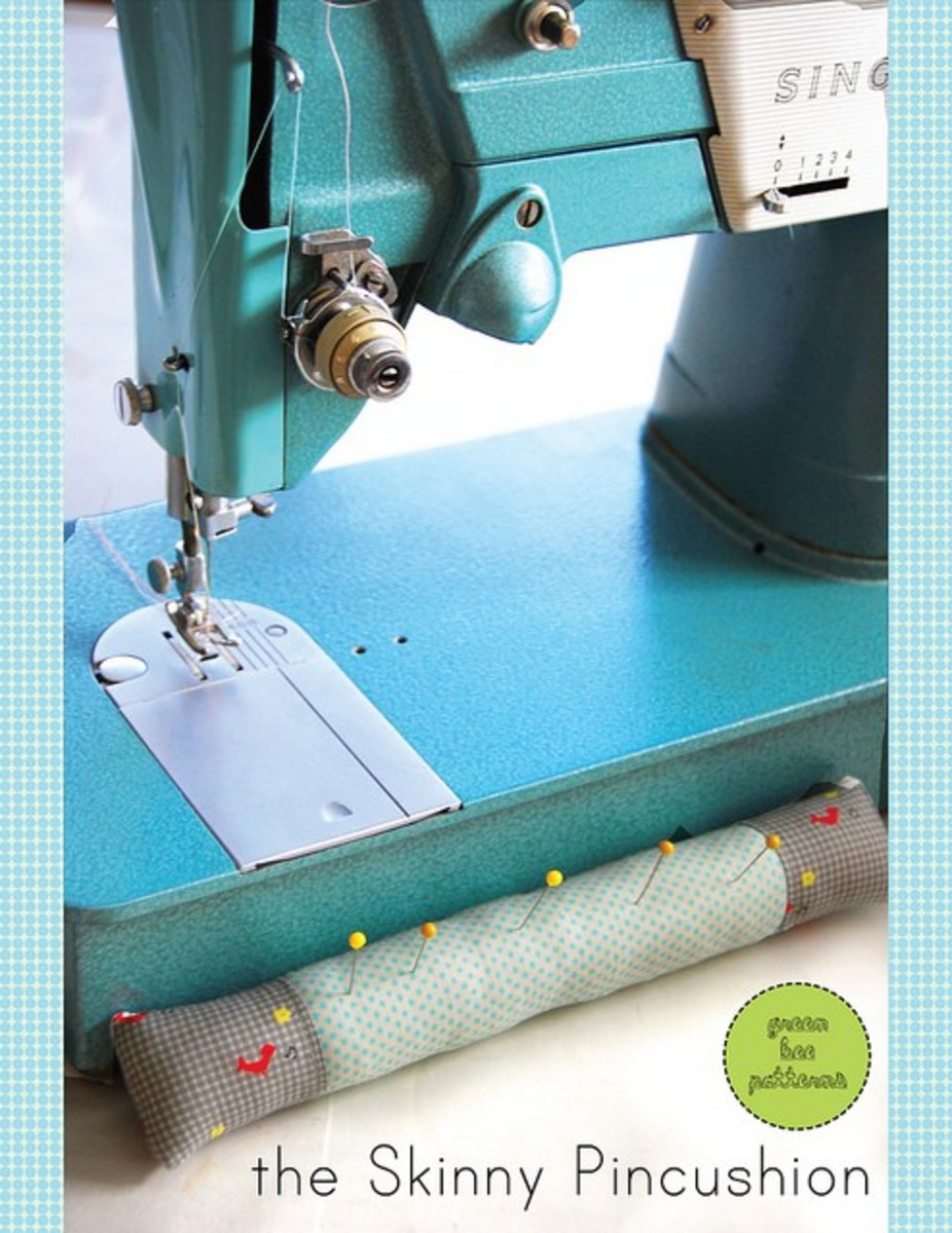 Consider creating a skinny pincushion that will fit right up against the sewing machine.