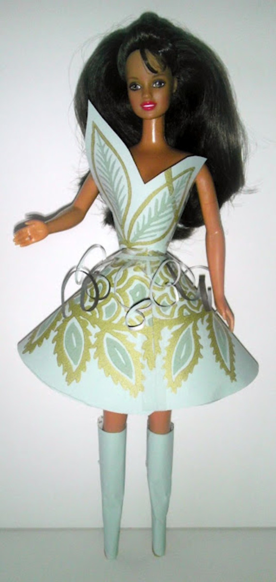 Get creative and dress Barbie up to look like a space princess.