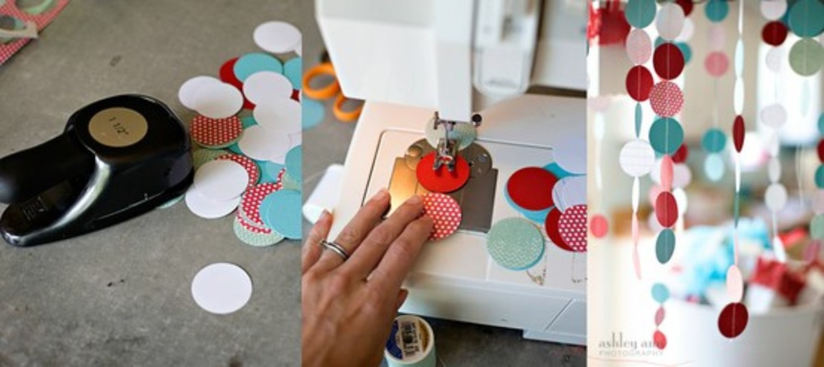 Circle Garland: Use a large circle punch to cut out circles from coordinating scrapbook pages and sew them together with a simple straight stitch. (click the link to see the rest of the decor for this beautiful diy turquoise, red and white party)