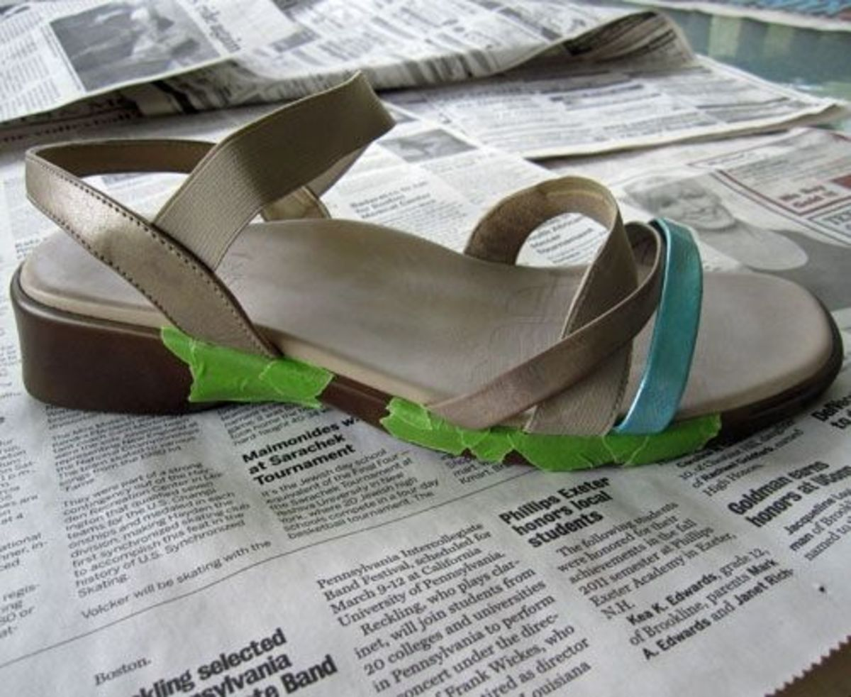 Photo of partially taped off leather sandal prior to painting