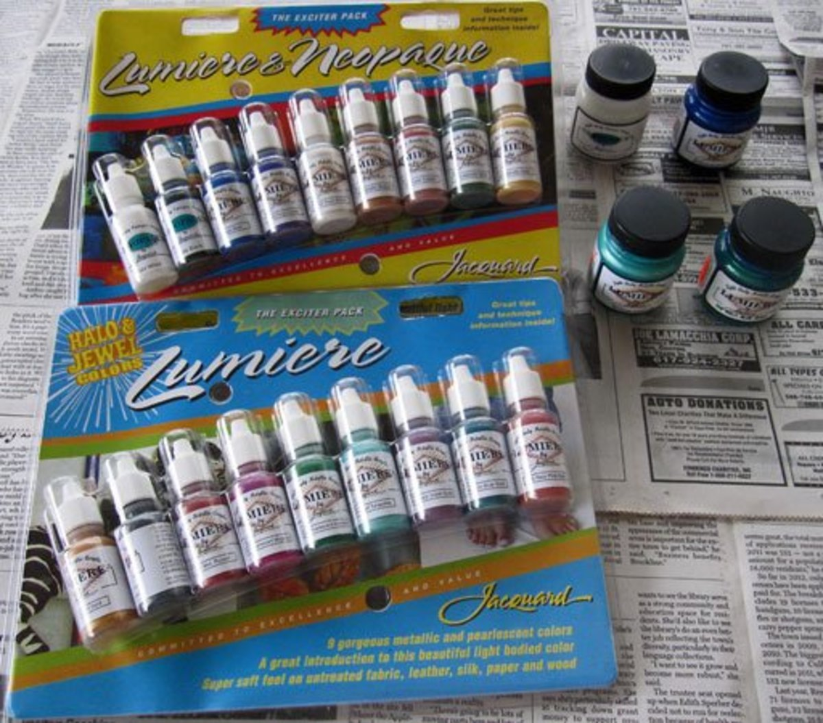Photo of Jacquard Lumiere and Neopaque acrylic paint exciter packs