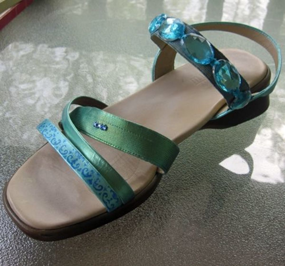 Aqua faux jewels sewn onto the stretched-out elastic strap.