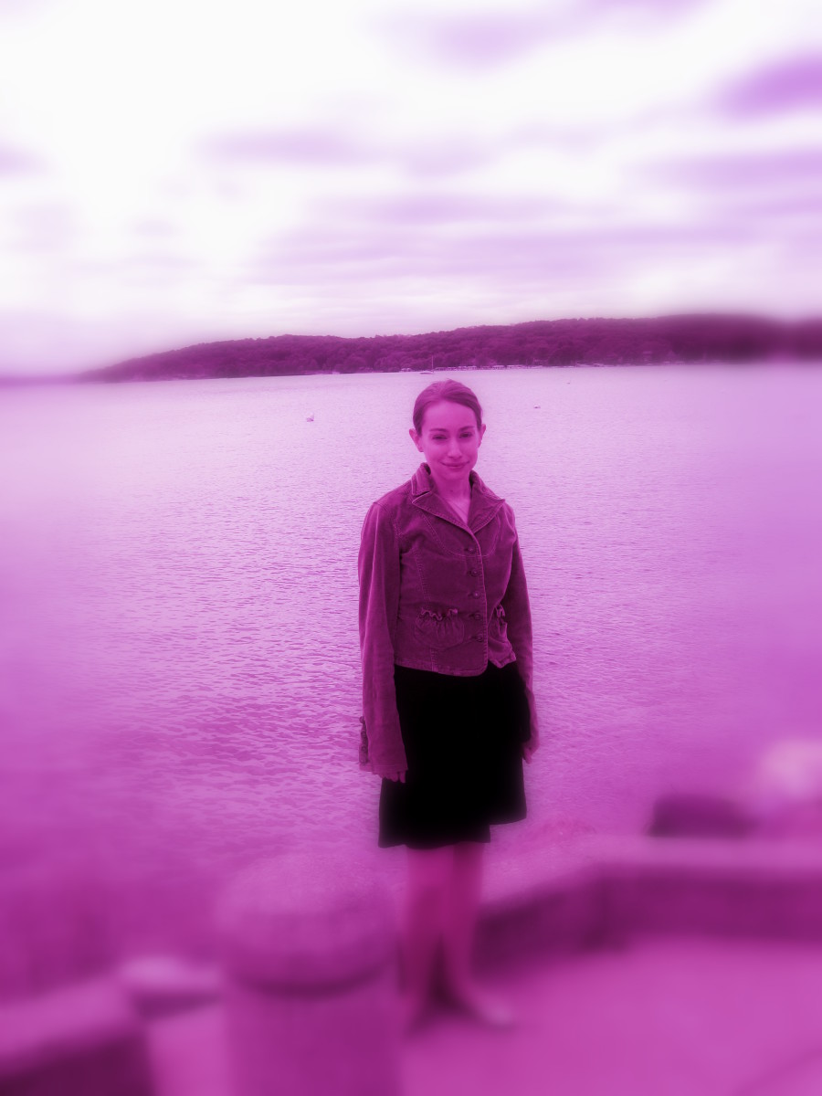 After completing a basic crop and light adjustment, I edited this photo of myself in with a purple tint and soft focus.  I did all of this with Picasa.